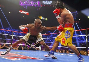 Floyd Mayweather stretching to land the body jab